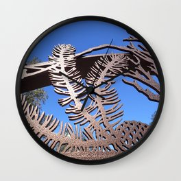 Pine branch blue skies Wall Clock
