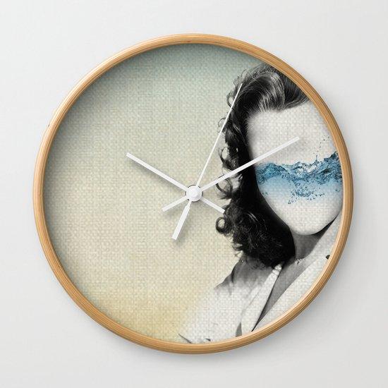 the glass half full Wall Clock
