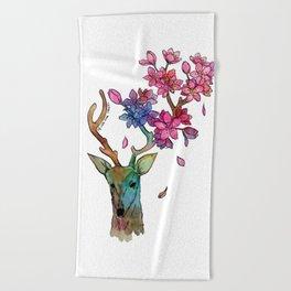 A deer with cherryblossom Beach Towel