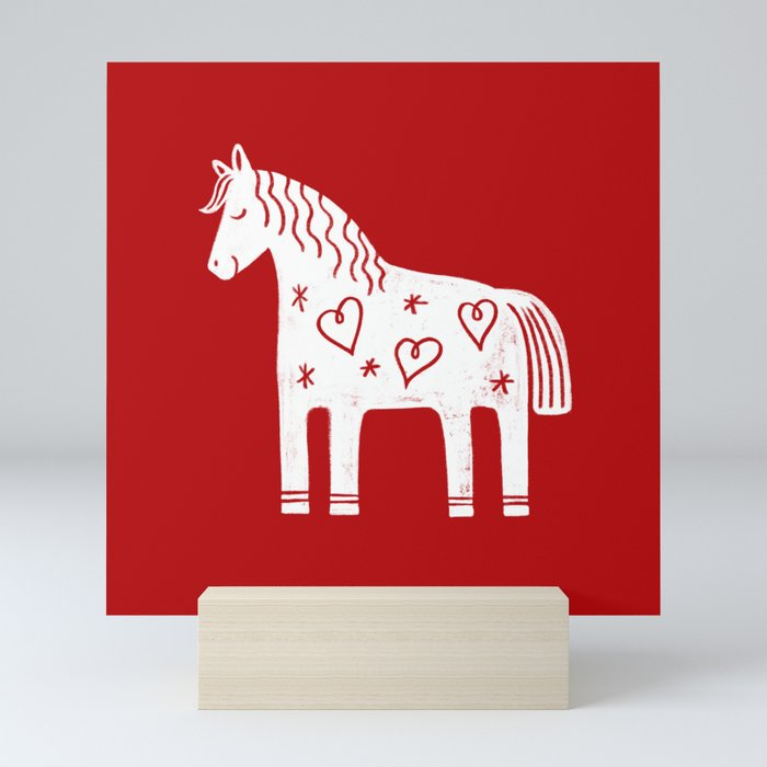 Dala horse on red Mini Art Print