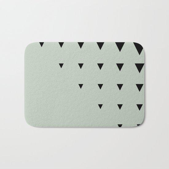 Black Triangles on Grey-Green Bath Mat