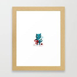 Sewing cat Framed Art Print