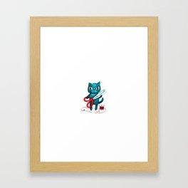 Sewing cat Framed Art Print