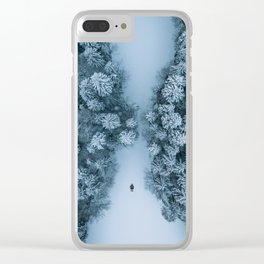 Man lying in the snow on a frozen lake in a winter forest - Landscape Photography Clear iPhone Case