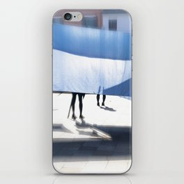 Blue bedsheet on the city street iPhone Skin