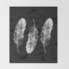 Three feathers on black background Throw Blanket