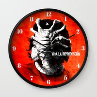 che Wall Clocks featuring CHE-HUGGER by BeastWreck
