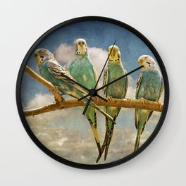 Parakeets perched on a branch againts a cloudy blue sky Wall Clock