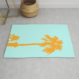Orange palm trees silhouettes on blue Rug