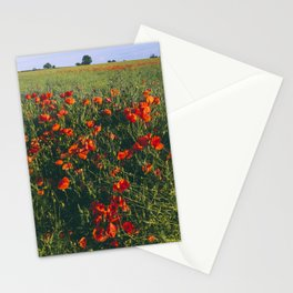Poppies growing wild in a field of rapeseed. Castle Acre, Norfolk, UK. Stationery Cards
