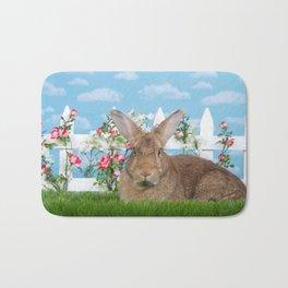 Large brown bunny rabbit in a flower garden Bath Mat