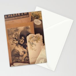 Nostalgic vintage background with yellowed sentimental portraits of glamour ladies, old post card, lace glove, feminine accessories,advertisement and russian 1900-s newspapers.Moscow,Russia,Jan 2021 Stationery Cards