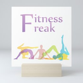 Fitness freak with people doing yoga Mini Art Print
