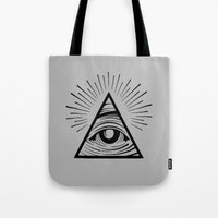 all seeing eye Tote Bags featuring ILLUMINATI ALL SEEING EYE by HAUS OF DEVON