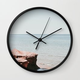 Pink rock ocean Wall Clock