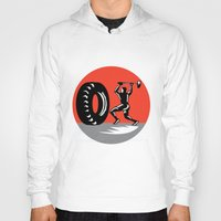 workout Hoodies featuring Tire Sledgehammer Workout Woodcut by patrimonio