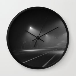 Strangers pass Wall Clock