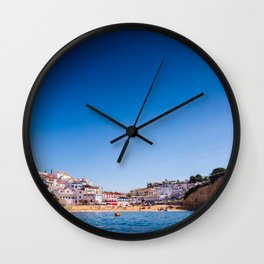 Carvoeiro Beach surrounded by dramatic Algarve cliffs in Portugal Wall Clock