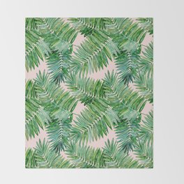 Green palm leaves on a light pink background. Throw Blanket