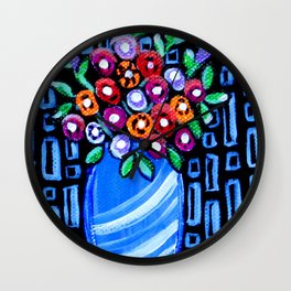 Flowers in a blue vase Wall Clock