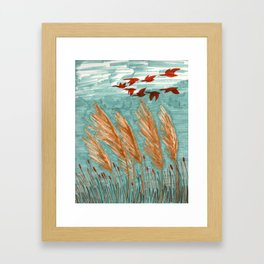 Geese Flying over Pampas Grass Framed Art Print