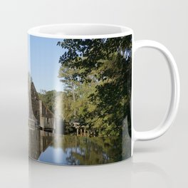Old Mill reflecting in a pond Coffee Mug