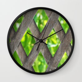 Metal material fence with green leafs at the background Wall Clock