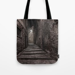 Medieval street that goes up narrow towards Bergamo Alta in the night Tote Bag