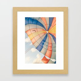 Colored parachute kite in the sky Framed Art Print