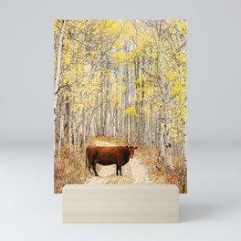 Cow in aspens Mini Art Print
