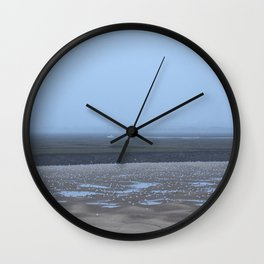 Birds; Gulls on mud flats at low tide on a foggy evening. Wells-next-the-sea, Norfolk, UK. Wall Clock