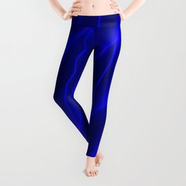 Slanting repetitive lines and rhombuses on luminous blue with intersection of glare. Leggings