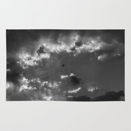 Plane and storm Rug