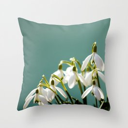 Snowdrops on a green -turquoise background Throw Pillow