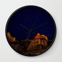 night sky Wall Clocks featuring night sky by haroulita