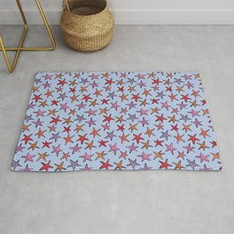 Starfishes in clear water Rug