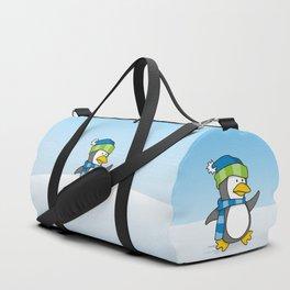 Little penguin walking on snow Duffle Bag