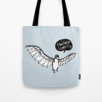 da vinci Tote Bags featuring Da Vinci Penguin by Nemimakeit