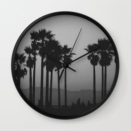 palms against the mountain Wall Clock