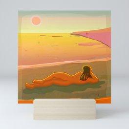 Woman Lying on the Beach Looking at the Horizon Mini Art Print