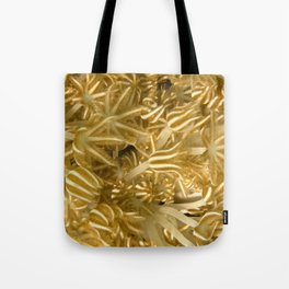 Grasping (in gold) Tote Bag