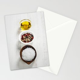 Salt, pepper and olive oil on a wooden board Stationery Cards