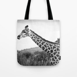 Giraffe walking in African Savanna Tote Bag