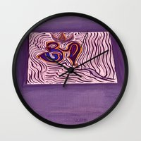 om Wall Clocks featuring om by Loosso