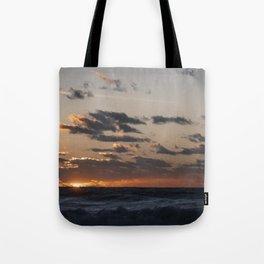 Sunset at dawn in the Ocean Tote Bag
