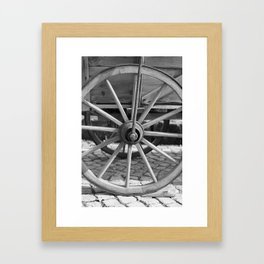 Old wooden cart wheel Framed Art Print