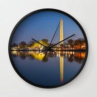 washington dc Wall Clocks featuring Washington DC Dawn Monument by Nicolas Raymond