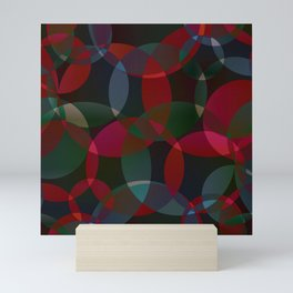 Abstract soap made of cosmic transparent green circles and claret bubbles on a dark background. Mini Art Print