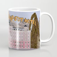 tenenbaums Mugs featuring THE GRAND BUDAPEST HOTEL by Kaitlin Smith