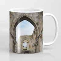 downton abbey Mugs featuring Glastonbury Abbey by Artemio Studio